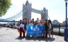 UB students gathered in front of one of the many iconic bridges in London, England during this year's SLIDE trip.
