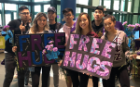 "Members of Sigma Psi Zeta and Lambda Phi Epsilon providing ""free hugs"" in support of mental health awareness and the UB Men's Group."