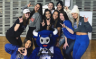 Women of Phi Sigma Sigma sorority hanging out with Victor E. Bull while attending a UB Men's Basketball game.