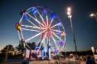 A night time spin on the ferris wheel during Homecoming and Family Weekend carnival.