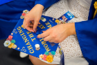 A student decorating their graduation cap.