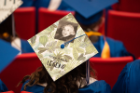 Decorated graduation cap at UB's commencement ceremony.