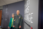 "Efner ""Lucky"" Davis and Barbara Wasielewski pose for a picture outside the new ""Lucky"" Davis Veterans Lounge in the Student Union following the new lounge dedication in May 2018."