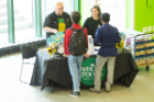 Students talking at a sponsor table in the Union