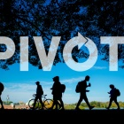 "Students walk across campus, with screened text ""PIVOT"" overlaying the image."