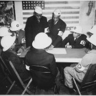 Air raid wardens at a sector meeting in Washington, DC, discuss the zones they control during a practice air raid ca. 1945-1941.