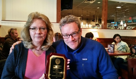 Rosemarie Gryckiewicz and Thomas Feeley pose in honor of Rosemarie's twenty years of service.