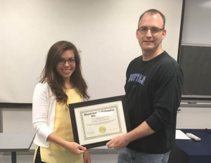 Tara Hudson (left) receives the 2016 Excellence in Graduate Student Teaching Award from David Hemmer, Chair, Department Mathematics.