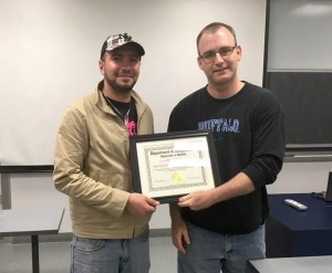 Abdalrazzaq Zalloum (left) receives the 2016 Excellence in Graduate Student Teaching, Honorable Mention Award, from David Hemmer, Chair, Department Mathematics.