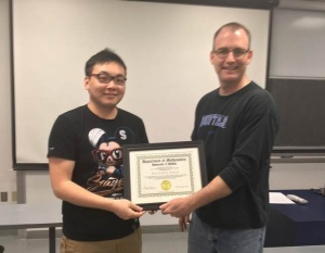Naijiang Zeng (left) receives the 2016 Excellence in Graduate Student Teaching, Honorable Mention Award, from David Hemmer, Chair, Department Mathematics.