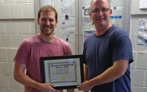Charles Cain (left) receives the 2017 Excellence in Graduate Student Teaching Award from David Hemmer, Chair, Department of Mathematics.