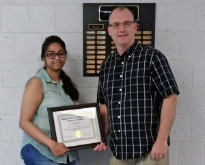 Navya Mandava (left) receives the 2017 Excellence in Graduate Student Teaching, Honorable Mention Award, from David Hemmer, Chair, Department of Mathematics.