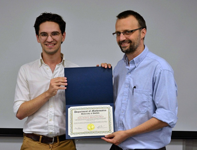 Michael Montoro, center, receives the first annual Summer Math Scholarship, presented by Dr. Joseph Hundley, Associate Professor and Director of Undergraduate Studies (left), and Dr. David Hemmer, Professor and Chair, Department of Mathematics (right).