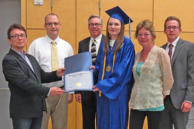 Jessica Eisenhauer, center, with family, receives the 2016 graduate certificate of summa cum laude. The award was presented by (pictured from left) Dr. Bernard Badzioch, Director of Undergraduate Studies, and Dr. David Hemmer, Chair, Department of Mathematics. Photograph by Dr. John Ringland.