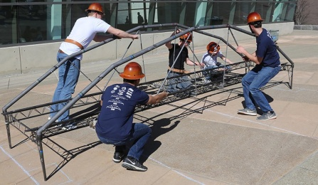 ASCE steel bridge team practices building outside of Davis Hall on north campus