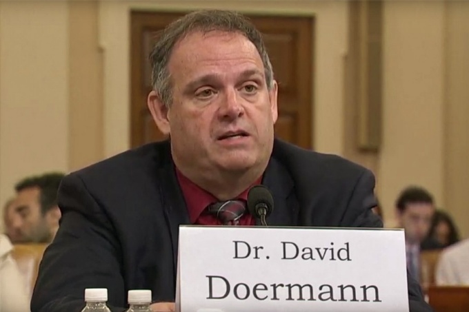 David Doermann, seated at a table, testifying before Congress.