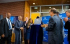 UB unveil a plaque celebrating the opening of the new Educational Opportunity Center.