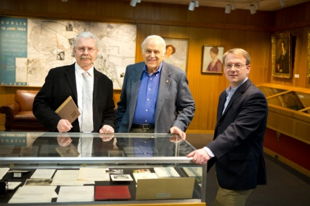 From left, Michael Basinski, Jonathan Reichert and James Maynard examine items in the Victor E. Reichert Robert Frost Collection, a collection of rare letters, audio files, photographs and other materials that chronicle a 24-year friendship between the poet and the Cincinnati rabbi.