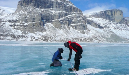 UB researchers take an ice sample in Canada's Baffin Island.