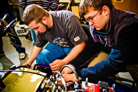 Photo of UB students working on a snowmobile.