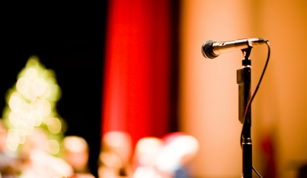 photo of a microphone on a stage.