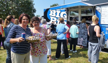 UB staffers check out Big Blue, UB's new food truck, during a dry run at Crofts Hall.