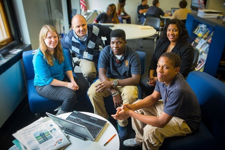 Nathan Daun-Barnett, second from left, with students at Bennett High School. Pictured with Daun-Barnett are, from left, UB graduate student Caitlin Kubala, Bennett student Kelvin Sika, UB graduate student Khristian King and Bennett student Lamont Owens.