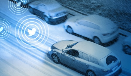 Cars on a snowy road and Twitter logos.