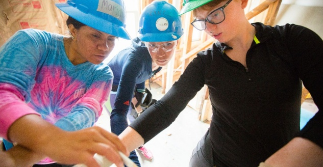 UB students working on a Habitat for Humanity home.