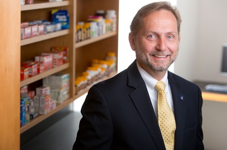 Karl Fiebelkorn pictured in a pharmacy setting.
