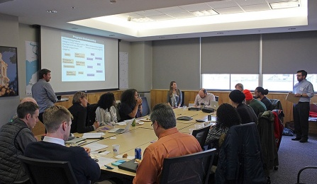 Workshop participants seated at a conference room table