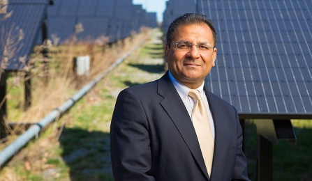 Amit Goyal in front of UB's Solar Strand