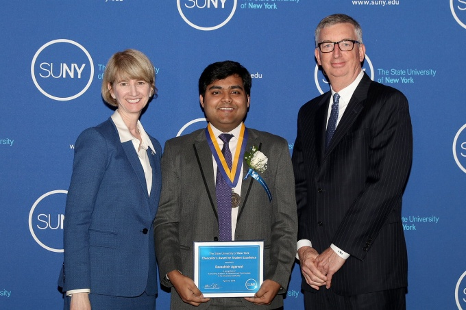 SUNY Chancellor Kristina Johnson and UB Vice President for Student Life A. Scott Weber congratulate Devashish Agarwal.
