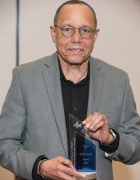 Photo of UB faculty member Henry Louis Taylor holding his award.