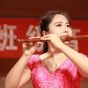 Photo of a student playing the flute.