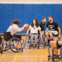 Photo of students participating in wheelchair basketball as part of an adaptive sports class offered by UB's Department of Rehabilitation Science.