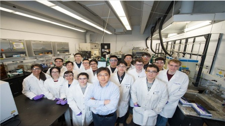 Gang Wu, front and center with arms crossed, in his lab with his students. Credit: Onion Studio.