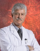 Steve Fliesler in white coat with red vision image in background.