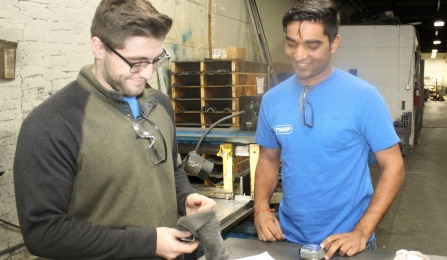 From left, students Jason Trivigno and Ruchit Patel learn facets of the manufacturing industry while contributing their skills to Ttarp Co.
