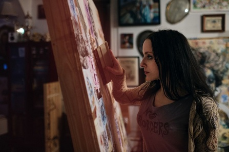 Artist Molly Crabapple working on an art project.