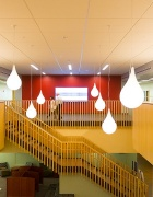 Tear-shaped light bulbs hanging over staircase.