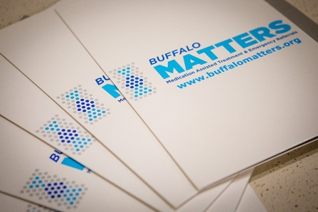 Folders with Buffalo MATTERS information displayed on a table.