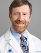 headshot of Bruce Troen in white coat.