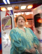 E. Brooke Lerne, PhD, standing in front of an ambulance that has its back doors open.