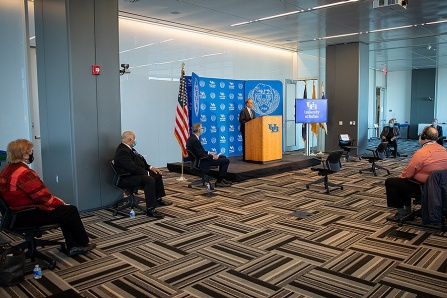 Press briefing at the CTRC with President Tripathi standing at the podium and seated from left to right: Nancy Nielsen, Kinzer Pointer, Tim Murphy and Henry Louis Taylor, Jr.