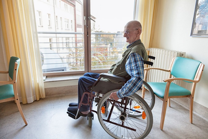Elderly man in a wheelchair
