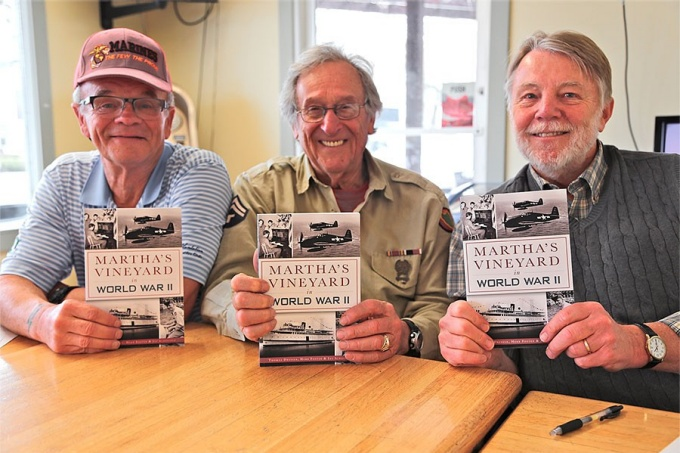 From left: Jay Schofield, Herb Foster and Tom Dresser each holding a copy of Martha's Vineyard in World War
