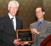 Richard Salvi, left, accepts Snow Award