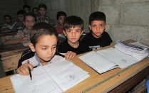 Syrian students in their Damascus basement classroom.