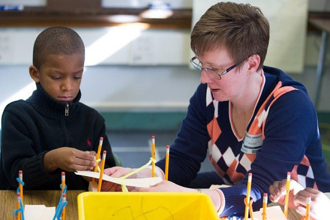 Jennifer L. Zirnheld conducts science experiment with a student at Westminster Community Charter School